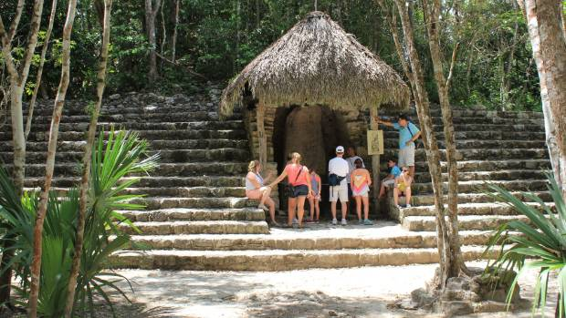 Tourists at the Coba ruins.