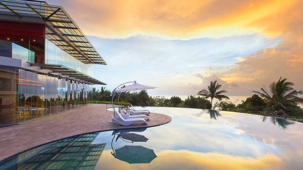 CHILD'S PLAY: Sheraton Kuta Bali hotel's infinity pool at sunset.