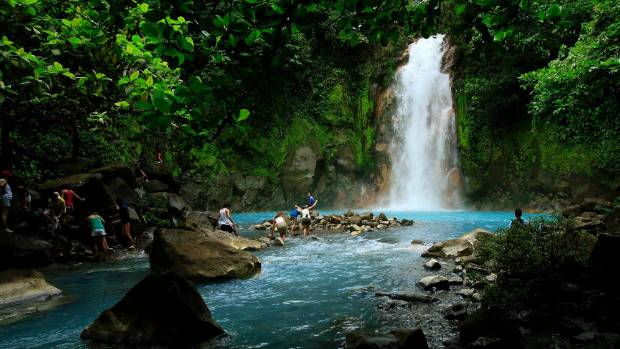 TAKE A LEAP: People swim in the Celeste river waterfall at Tenorio Volcano National Park in Upala, Costa Rica.