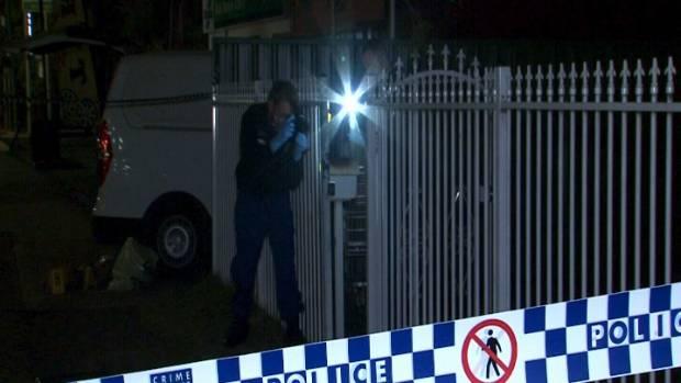 STABBING SCENE: Police at the scene of the stabbing.