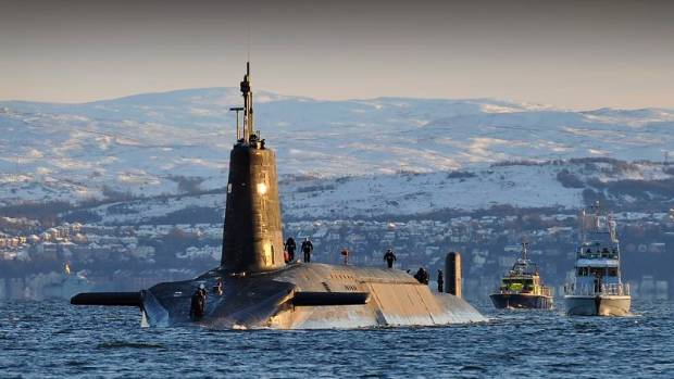 HMS Vanguard, one of Britain's four nuclear submarines, returns to its base in Faslane, Scotland, following a patrol.