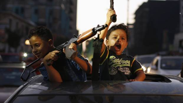 Palestinians celebrate as ceasefire with Israel over Gaza appears to be holding.
