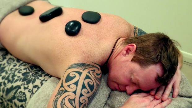 HOT ROCKS: Trying out Brackenridge Resort's hot stone massage at the in-house spa.