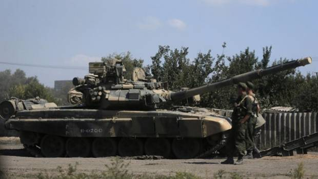 Russian soldiers are pictured next to a tank in Kamensk-Shakhtinsky, Rostov region, near the border with Ukraine.
