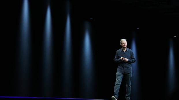 PRODUCT LAUNCH: Apple CEO Tim Cook, seen at an event in June, hasn't provided any concrete clues on what the company ...