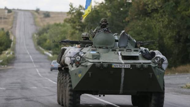 Ukrainian servicemen ride in an armoured vehicle near Debaltseve, Donetsk.