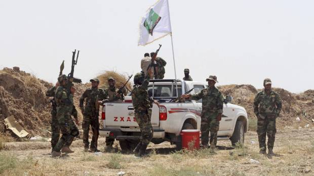 Iraqi security forces and Shiite militiamen chant anti-terrorism slogans after breaking the siege of Amirli following US ...
