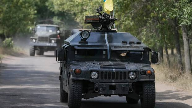 Ukrainian servicemen ride in an armoured vehicle in Kramatorsk.