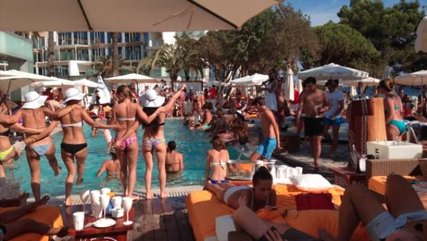 SINFUL PLEASURES: Fork out the cash for a day bed at a beach club. Try the new Nikki Beach in San Antonio.