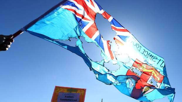 DISCONTENT: Protests against Frank Bainimarama in Auckland in August included burning flags.