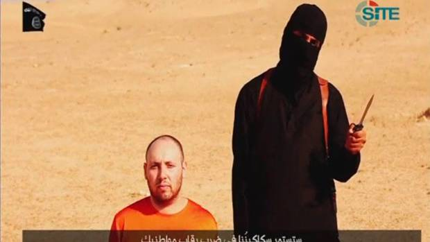DESPICABLE: A masked Islamic State fighter holds a knife before slaying US journalist Steven Sotloff in this screengrab ...