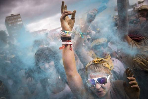 People throw brightly coloured powder at the Holi One festival at Wembley Park in London, England. The event is inspired ...