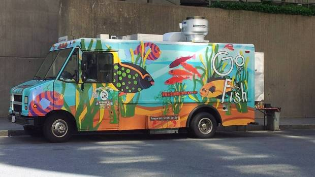 FOOD ON THE MOVE: A Go Fish food truck parked in Back Bay area, Boston.