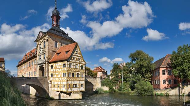 The trail runs past the town hall on the bridge in Bamberg, Germany.
