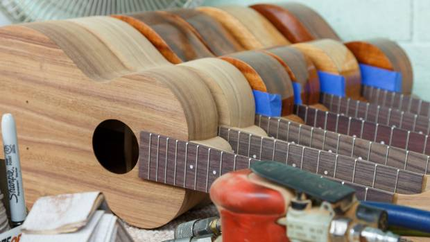 BABY GUITARS: New ukuleles on the production line at the Kamaka factory.