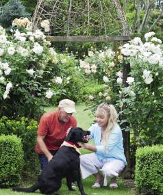Keith Norris and Kaye Pickering with Harvey, a Labrador cross who was abandoned near their gate as a puppy.