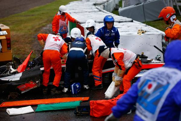 Track medical officials attempt to free Jules Bianchi from his car following the crash.