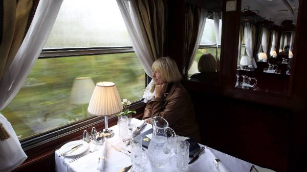 The rail rhythm: The luxury cars have been retrofitted from historic models to reflect times gone. A passenger sits in ...