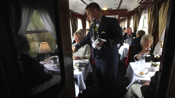 Lunch is served aboard a historic Tehran-bound train.