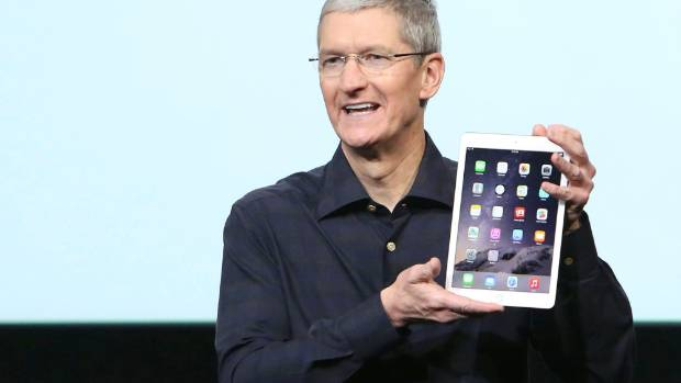 Apple CEO Tim Cook with a new iPad.