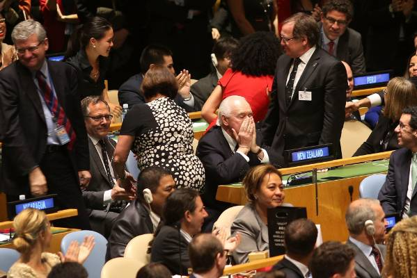 Jim McLay (hands over mouth), New Zealand's United Nations Permanent Representative, reacts as Foreign Minister Murray ...
