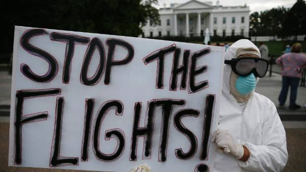 FEARFUL: A protester demonstrates in favour of a travel ban in front of the White House last week.