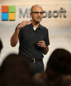 CEO Satya Nadella gestures while speaking during a Microsoft cloud briefing event in San Francisco.