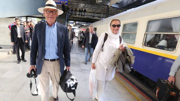 Tourists walk on a platform at a station in Tehran after arriving in the Iranian capital on a luxury train from Budapest.