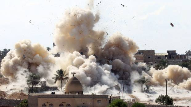 HOMES RAZED: Smoke and debris above Rafah after a house is demolished.