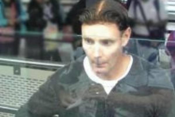 Phillip John Smith, pictured as he was passing through Auckland Airport on his way out of the country.