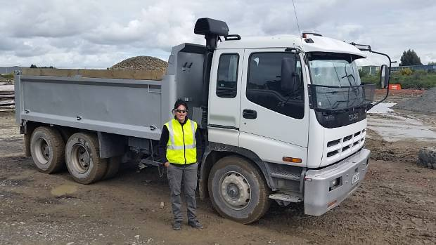 READY TO DRIVE: Justine Burt stands next to a Class 4 tip truck at a quarry on Springs Rd.