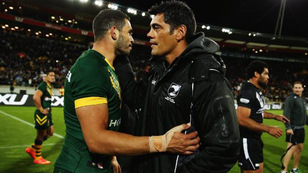 WELL DONE: Kangaroos star Greg Inglis congratulates Kiwis coach Stephen Kearney on his side's Four Nations title triumph.