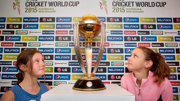 CUP OF DREAMS: Kahlyss Boyer, 13, and her sister Madison, 12, admire the ICC Cricket World Cup trophy on display at ...