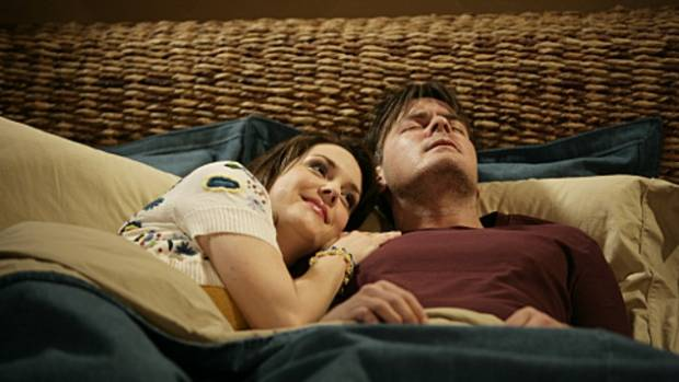 COMEDY GOLD: Rose (Melanie Lynskey) and Charlie Harper (Charlie Sheen).