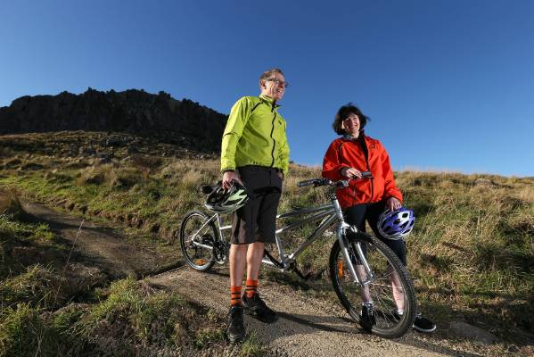 Roger Sutton and Karleen Edwards, Christchurch City Council chief executive, test a newly opened Port Hills  bike path ...