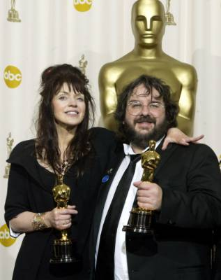 Peter Jackson and his wife Fran Walsh with their Oscar statues after The Lord of the Rings: The Return of the King won ...