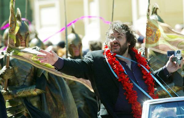 Peter Jackson waves to fans during a parade through central Wellington at the world's premiere of the third and final ...