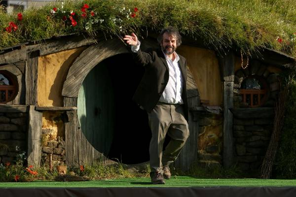 Peter Jackson emerges from from a Hobbit house before delivering a speech at the The Hobbit: An Unexpected Journey world ...