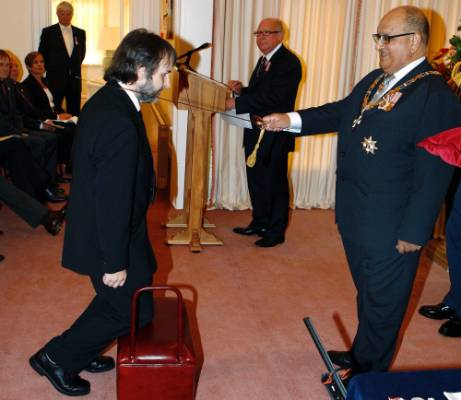 Peter Jackson is knighted by then Governor-General Anand Satyanand at Premier House in Wellington April 28, 2010.