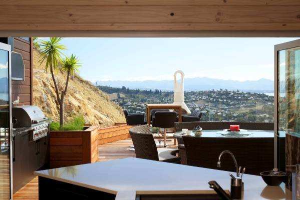EXTRA ROOM: The covered outside space is an extension of the indoor living in every way - cooking, dining and relaxing.