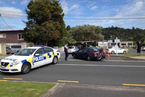 Police at the scene of a reported stabbing in the Auckland suburb of Albany.