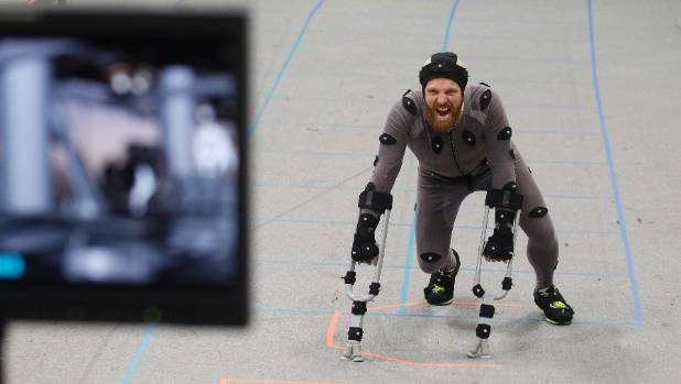 HANDS ON: Stunt man Isaac Hamon, who also worked on The Hobbit, makes moving with the rolling gait of a chimp look easy. ...