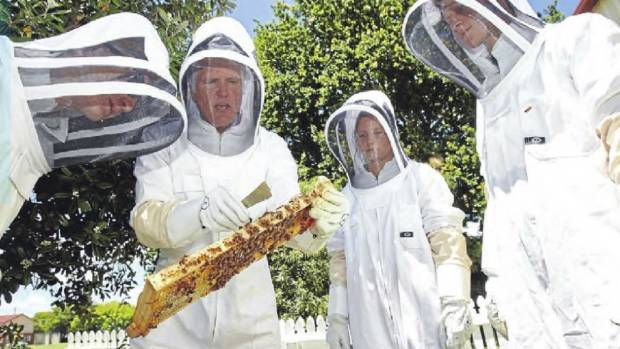 St Paul's Collegiate School students Logan Spaans, Georgia Burke and Jaime King study beekeeping with teacher Chris ...