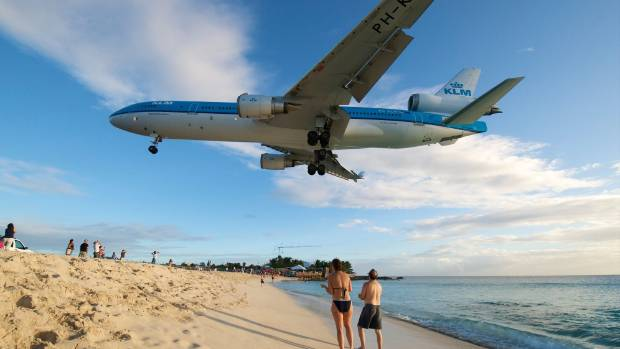 Sint Maarten is a popular destination for plane spotters, as the planes fly low over Maho Beach into the airport. (File ...