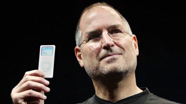 Apple CEO Steve Jobs holds up the new iPod Nano after it introducing in September 2005.