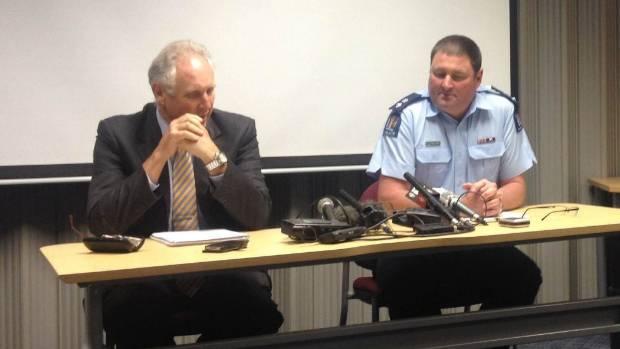SADDENED: Superintendent Russell Le Prou (right), Detective Inspector Stuart Allsopp-Smith.