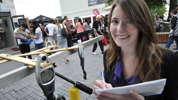 Victoria Toner draws people into her research with a tripod of GPS devices in Cashel Mall.
