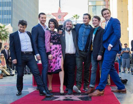Peter Jackson  poses by his star, with actors (from L-R) Andy Serkis, Richard Armitage, Evangeline Lilly, Orlando Bloom, ...