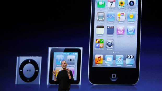 Images of the iPod Shuffle, iPod Nano and iPod Touch are projected onscreen behind Apple Chief Executive Steve Jobs in 2010.
