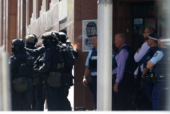 Police, including am armed offenders squad, on Sydney's Martin Place.